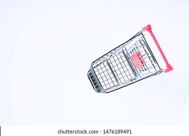 Empty top view mini pink shopping cart  or trolley shopping on white background, concept shopping in supermarket.
