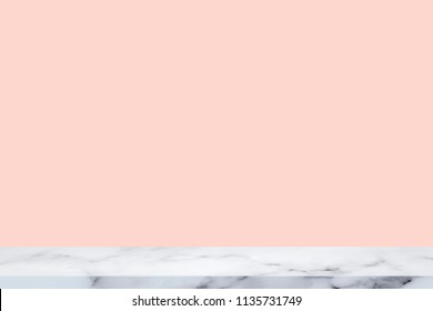 Empty top of white marble table with pink wall background.