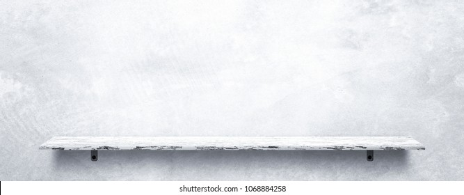 Empty top white wooden shelves with grunge cement or concrete wall texture background.Counter for display or montage of product.