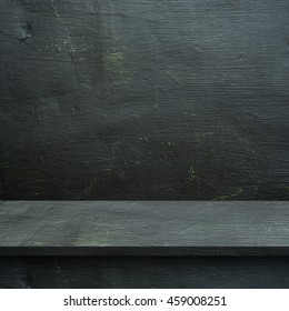 Empty top wood   shelves or table  on Black board  wall background.For put product and some thing