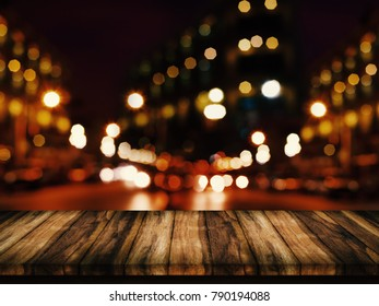 Empty top of wood table with abstract urban night light bokeh background