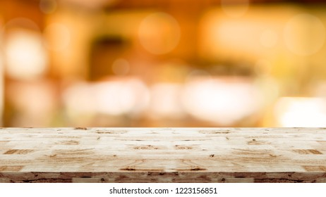 Empty top of wood table with blurred interior in cafe background