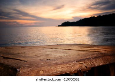 Empty Top of wood table with blurred Twilight sea background. For Product display montage. Beach in summer Concept.