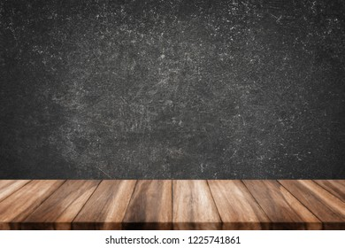 Empty top of wood table with grunge concrete wall texture background.