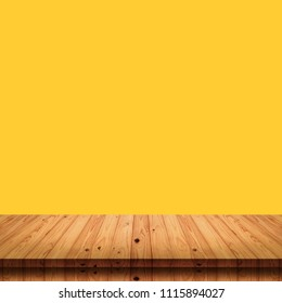 Empty top of wood table on yellow background.