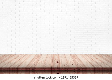 Empty top of wood table with white brick wall texture background. For display or montage your products.