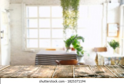 Empty Top Wood table.background living room blur .