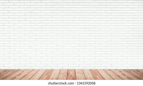 Empty top of wooden floor with white brick wall texture background.