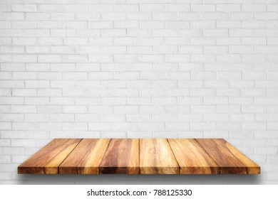Empty top of wooden shelf with white brick wall background. For display or montage your products.