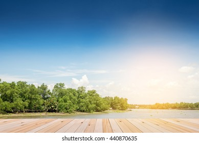 Empty top of wooden shelves on sky and river front view background. For product display