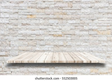 Empty top wooden shelves and stone wall background. For product display.
