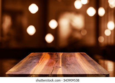 Empty top wooden table and blur with bokeh background. For product display