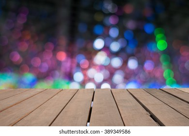 Empty top wooden table and blurred image of christmas lighting bokeh background. for your product display