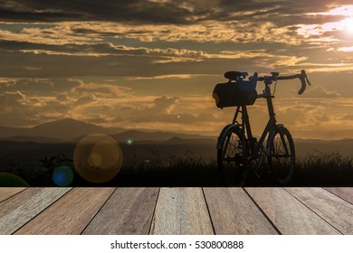 Empty top wooden table on view of landscape