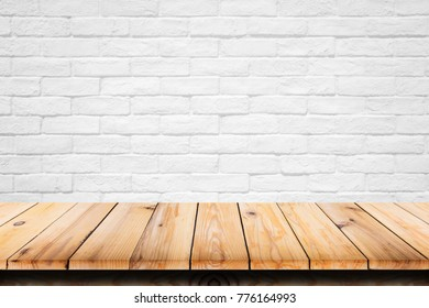 Empty top of wooden table on white brick background. For display or montage your products