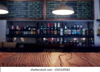 Empty top of wooden table perspective or counter on cafeteria, bar, coffeeshop background. For product display