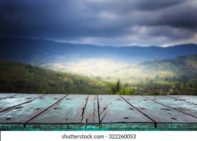 Empty top wooden table and view of mountain for product display