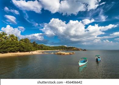 Empty tourist sea trip boats at Om beach in Gokarna, India
