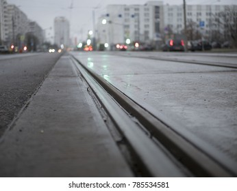 empty tram rails in the background of the city