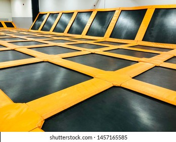 Empty trampoline surface indoor jump sport and fun activity
