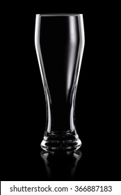 Empty transparent beer glass isolated on black background