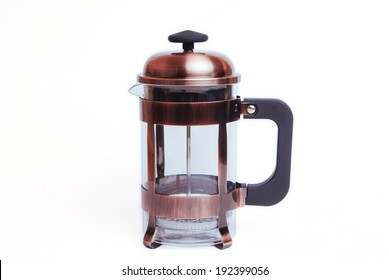 Empty transparent french press coffee and tea maker isolated on white, brown metallic
