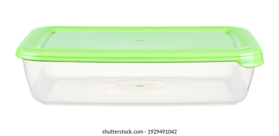 Empty transparent plastic food container with closed green lid isolated on white background