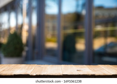 Empty tropical wood table and blurred garden cafe light background. product display template.Business presentation
