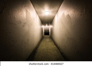Empty tunnel at night with stairs