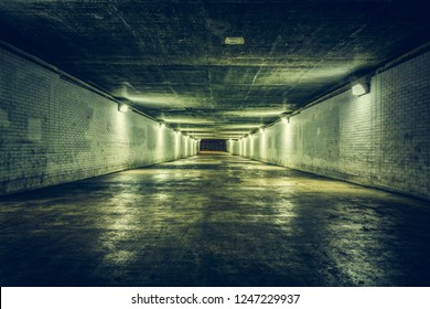 Empty tunnel with stairs at night