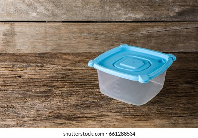 Empty tupperware, containers for food on wooden table background