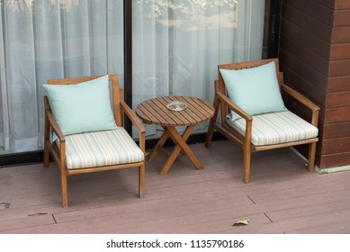 Empty two chairs and table in balcony or terrace - decoration interior
