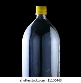 empty two liter bottle on black