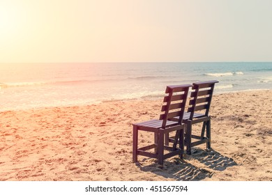 Empty Two Wood Chair on The Beach in Sunny day, Low Season Sea Travel No Tourist Concept.