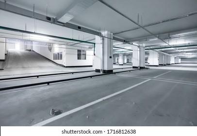 Empty underground parking lot or garage. Space for car parking - empty garage