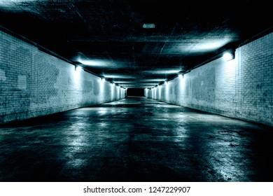 Empty underground tunnel at night