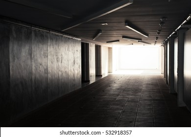 Empty underpass corridor. Dark abstract underground tunnel interior with glowing end