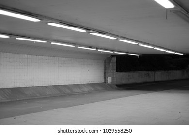 Empty underpass at night with fluorescent lighting strips