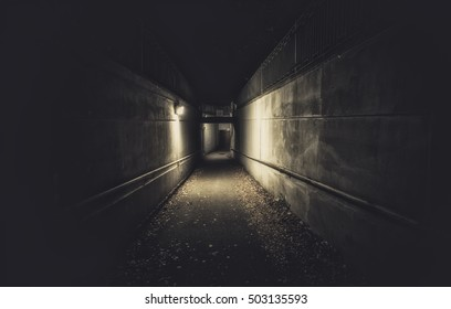 Empty underpass tunnel at night