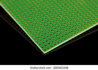 Empty universal printed circuit board PCB with drilled holed for elctronics component and prototyping