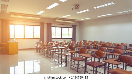 Empty university classroom with wooden chairs and desks. Modern university lecture room without student.