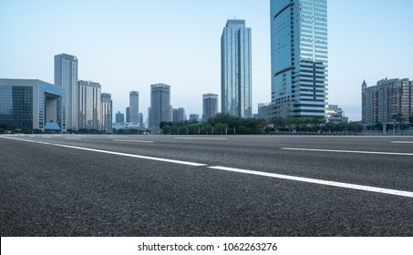 empty urban road with city skyline on background?tianjin,China,Asia.