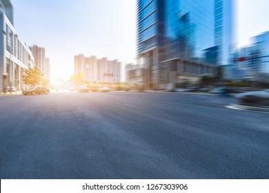 Empty urban road and modern skyline