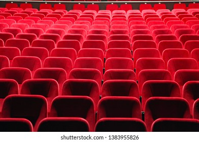 Empty velvet seats for spectators in the theater or cinema