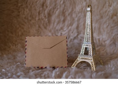 Empty vintage card with statuette of Eiffel Tower. High sharpness.