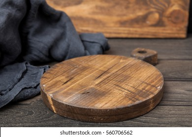 Empty vintage cutting board on dark wooden planks food background concept