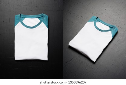 Empty vintage folded t-shirt lies on a black wooden table background. Front view of American Hipsters retro classic clothes