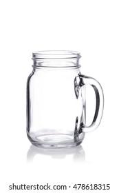 Empty vintage Mason jar with handle on white background reflection
