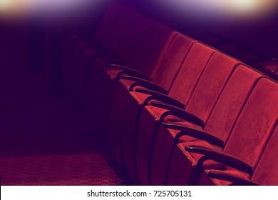 empty vintage red seats in movie theater auditorium