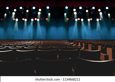 empty vintage seat in auditorium or theater with lights on stage.